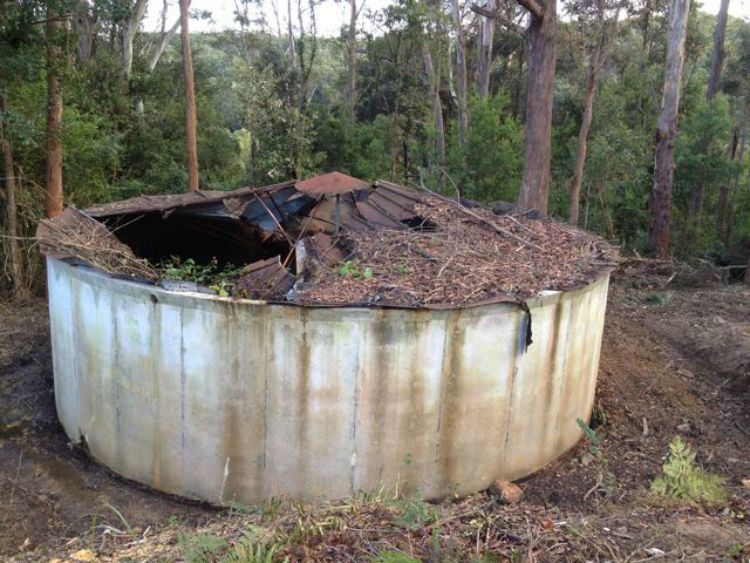 A concrete water tank that needs repairs